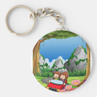 RoadtripPeople riding along the green forest Basic Round Button Key Ring