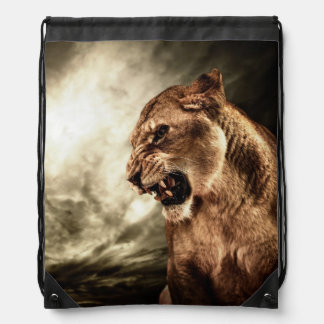 Roaring lioness against stormy sky drawstring bag