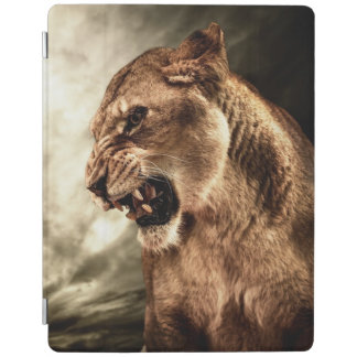 Roaring lioness against stormy sky iPad cover