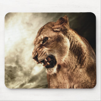 Roaring lioness against stormy sky mouse mat