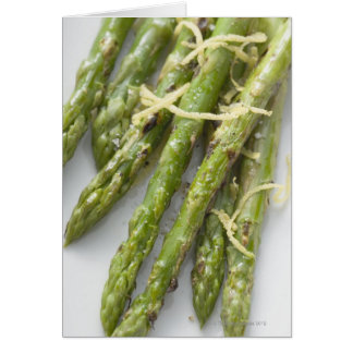 Roasted green asparagus with lemon zest, card