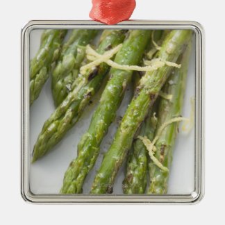 Roasted green asparagus with lemon zest, christmas ornament