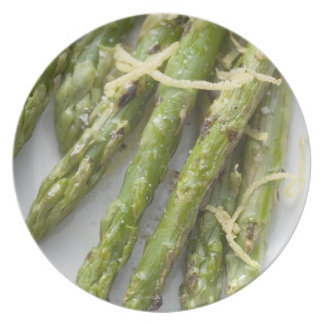 Roasted green asparagus with lemon zest, party plates