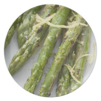 Roasted green asparagus with lemon zest, plate