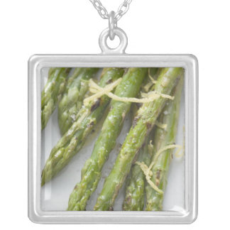 Roasted green asparagus with lemon zest, silver plated necklace
