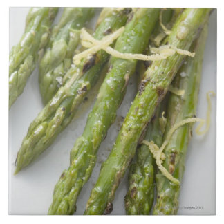 Roasted green asparagus with lemon zest, tile