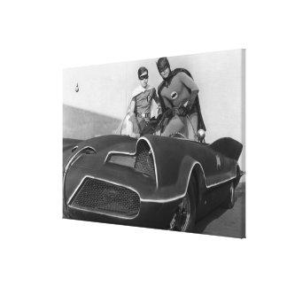 Robin and Batman Standing in Batmobile Canvas Print