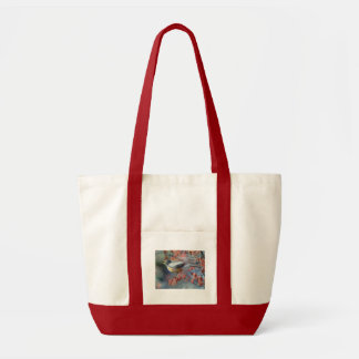 Robin eating berry tote bag