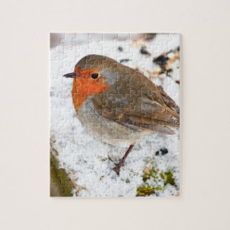 Robin on a snowy log jigsaw puzzle