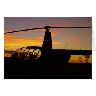 Robinson R44 helicopter at sunset Greeting Card