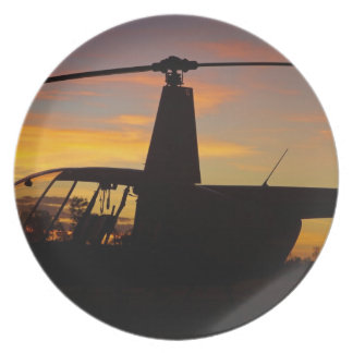 Robinson R44 helicopter at sunset Plate