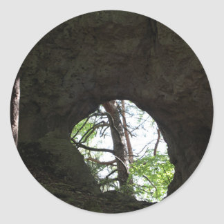 Rock wall with a hole round sticker