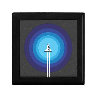 Rocket ship flies past the Blue Planet Gift Box