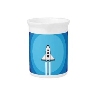 Rocket ship flies past the Blue Planet Pitcher
