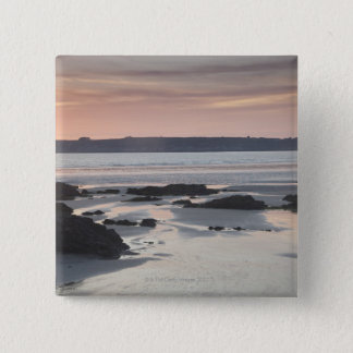Rocky beach at sunset 15 cm square badge