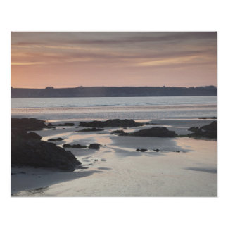 Rocky beach at sunset poster