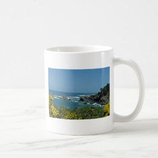 Rocky Coast Through Yellow Flowers flowers Coffee Mugs