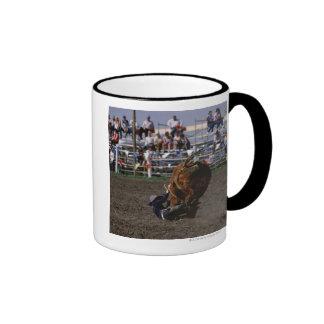 Rodeo rider falling from bull mug