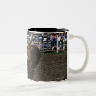 Rodeo rider falling from bull Two-Tone mug