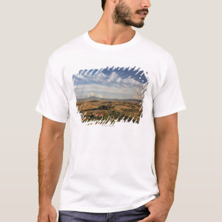 Rolling farm land after the harvest at sunset T-Shirt