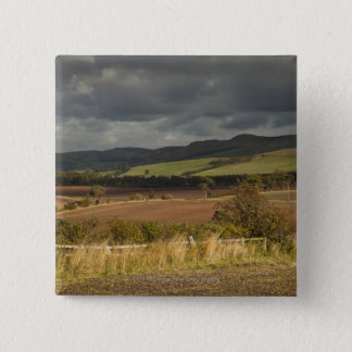 Rolling Hills And Mountains Under A Cloudy Sky 15 Cm Square Badge