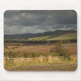 Rolling Hills And Mountains Under A Cloudy Sky Mouse Mat
