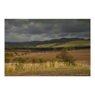 Rolling Hills And Mountains Under A Cloudy Sky Poster