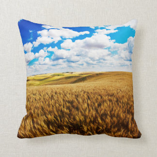 Rolling hills of ripe wheat throw pillow