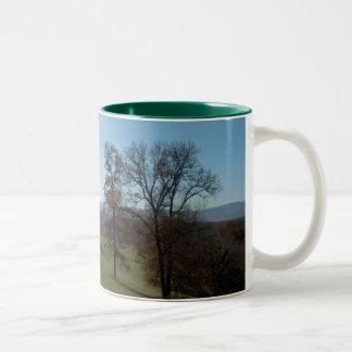 Rolling meadow and trees coffee mug