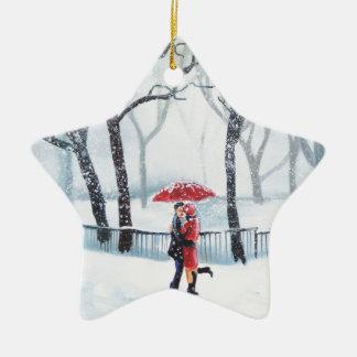Romantic couple dancing in the snow red umbrella ceramic star decoration
