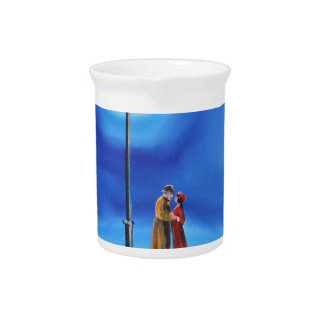Romantic couple under a street lamp drink pitcher