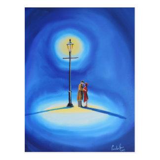 Romantic couple under a street lamp postcard
