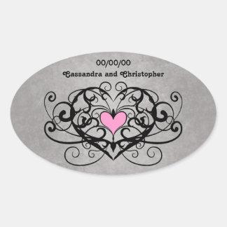 Romantic swirls and hearts wedding oval sticker
