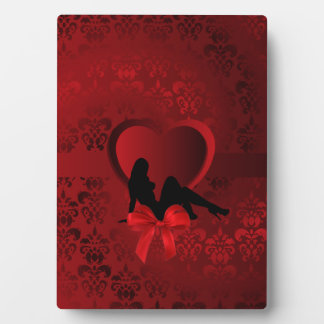 Romantic woman on red damask plaque