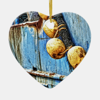 ropes and rusty ceramic heart decoration