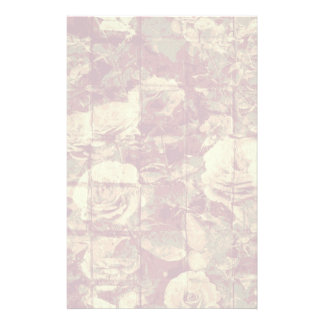 Rose camouflage pattern on tiled wall background stationery design