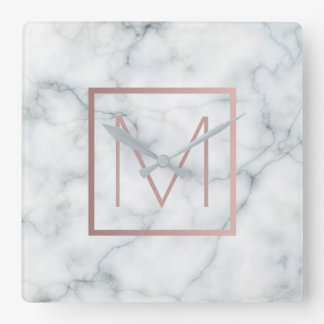 rose gold monogram on white marble stone clock