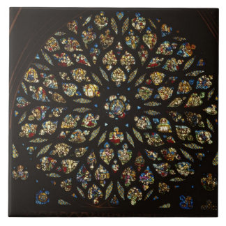 Rose window above the west door, with scenes depic tile