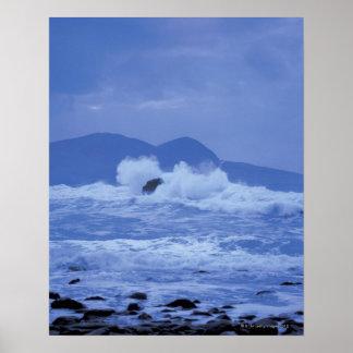 rough seas crashing against a rocky shore poster