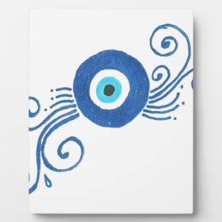 round blue evil eye plaque