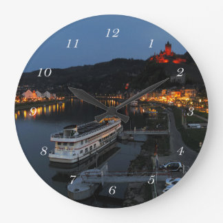 Round clock Cochem at Moselle in the evening