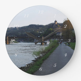 Round clock Cochem Moselle bank in the evening