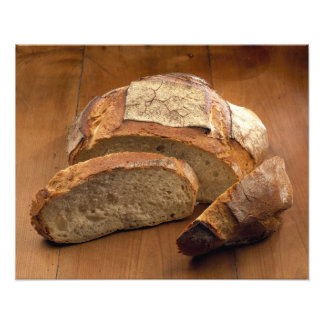 Round country-style bread cut in slices For Art Photo