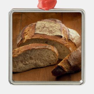 Round country-style bread cut in slices For Silver-Colored Square Decoration