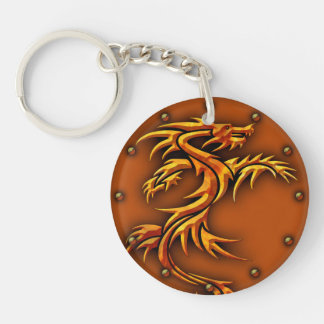 Round keychain with a dragon design