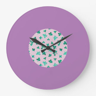 Round large wall clock with clover leaves on pink