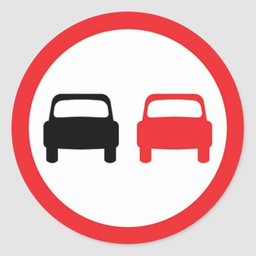 Round sticker with no overtaking traffic sign.