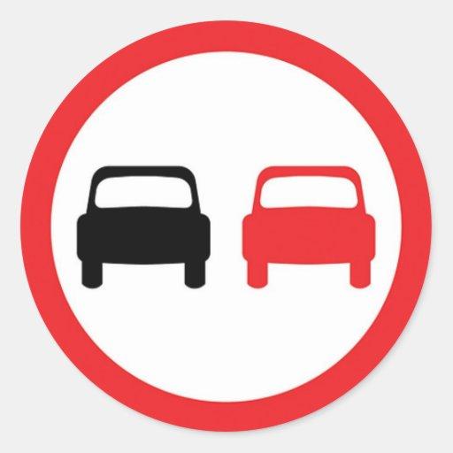 Round sticker with no overtaking traffic sign.