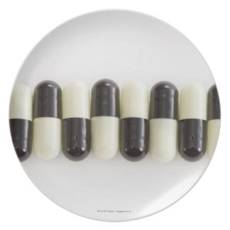 Row of Black and white pills Plate