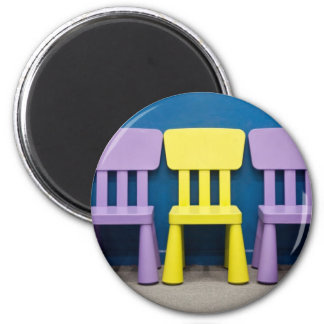 Row of children s chairs magnet
